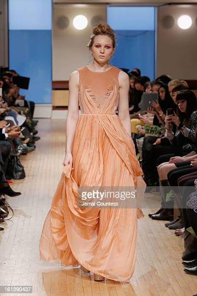 A model walks the runway at the Leanne Marshall fall 2013 fashion show during MercedesBenz Fashion Week at Helen Mills Event Space on February 10...