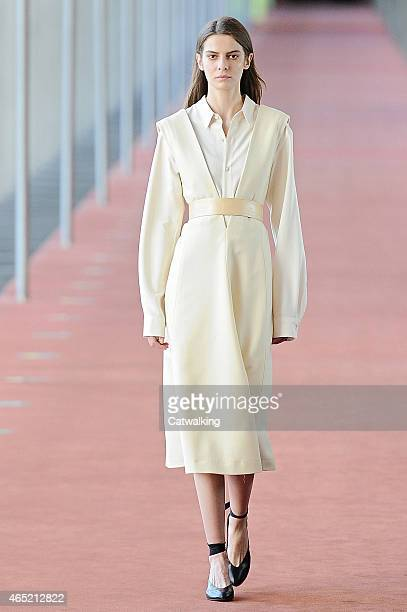 Model walks the runway at the Lemaire Autumn Winter 2015 fashion show during Paris Fashion Week on March 4, 2015 in Paris, France.