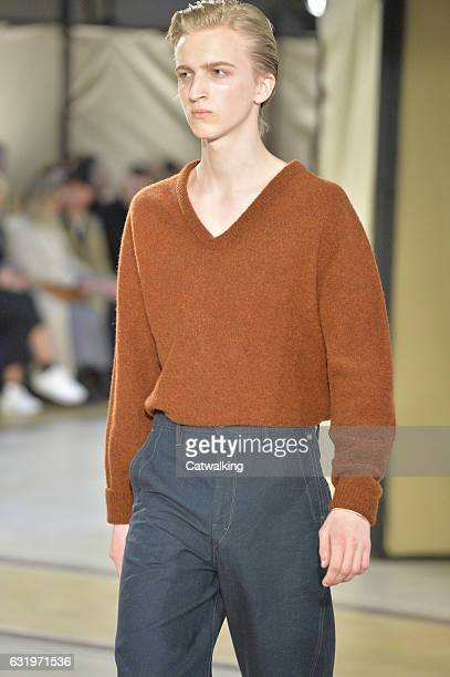 Model walks the runway at the Lemaire Autumn Winter 2017 fashion show during Paris Menswear Fashion Week on January 18, 2017 in Paris, France.
