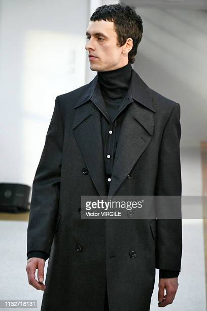A model walks the runway at the Lemaire Ready to Wear fashion show during Paris Fashion Week Autumn/Winter 2019/2020 on February 27 2019 in Paris...