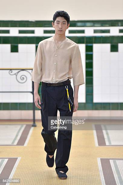 Model walks the runway at the Lemaire Spring Summer 2017 fashion show during Paris Menswear Fashion Week on June 22, 2016 in Paris, France.