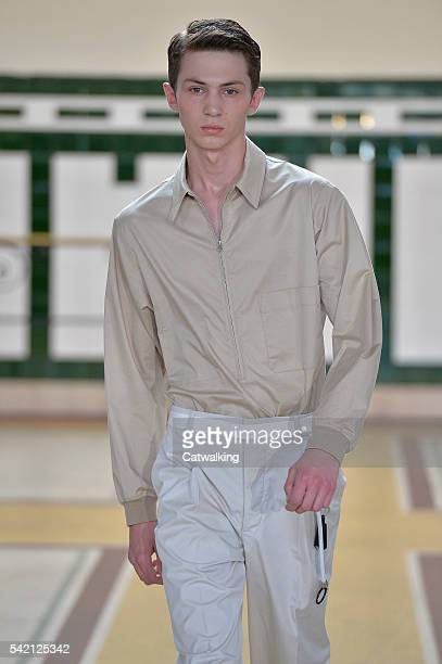 A model walks the runway at the Lemaire Spring Summer 2017 fashion show during Paris Menswear Fashion Week on June 22 2016 in Paris France