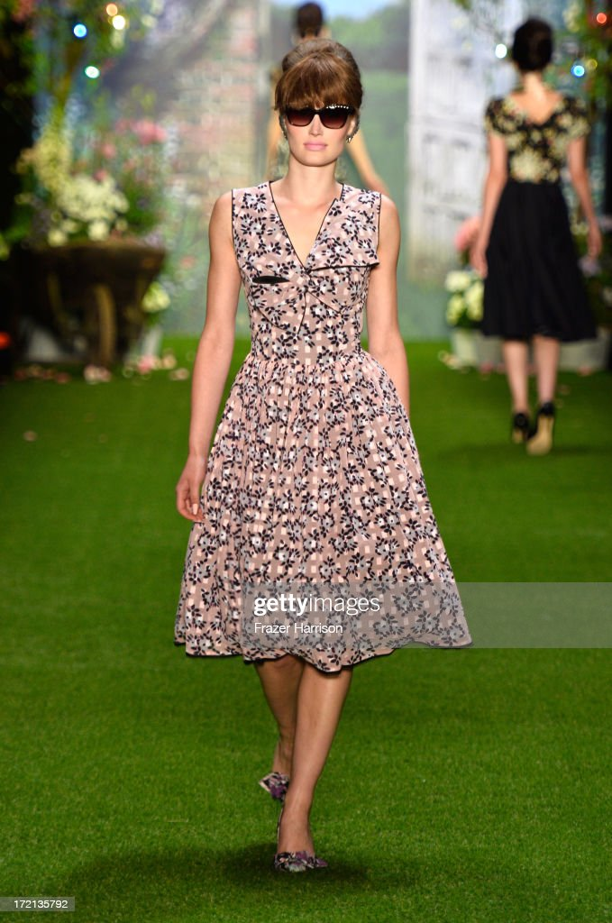 A model walks the runway at the Lena Hoschek show during Mercedes-Benz Fashion Week Spring/Summer 2014 at Brandenburg Gate on July 2, 2013 in Berlin, Germany.