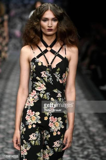 Model walks the runway at the Lena Hoschek show during the Berlin Fashion Week Spring/Summer 2020 at ewerk on July 03, 2019 in Berlin, Germany.