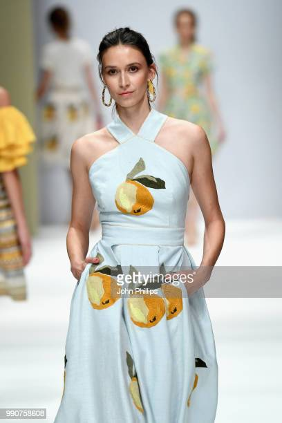 A model walks the runway at the Lena Hoschek show during the Berlin Fashion Week Spring/Summer 2019 at ewerk on July 3 2018 in Berlin Germany