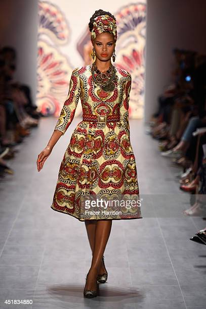 Model walks the runway at the Lena Hoschek show during the Mercedes-Benz Fashion Week Spring/Summer 2015 at Erika Hess Eisstadion on July 8, 2014 in...
