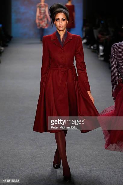 A model walks the runway at the Lena Hoschek show during the MercedesBenz Fashion Week Berlin Autumn/Winter 2015/16 at Brandenburg Gate on January 20...