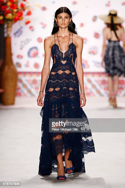 A model walks the runway at the Lena Hoschek show during the MercedesBenz Fashion Week Berlin Spring/Summer 2016 at Brandenburg Gate on July 7 2015...