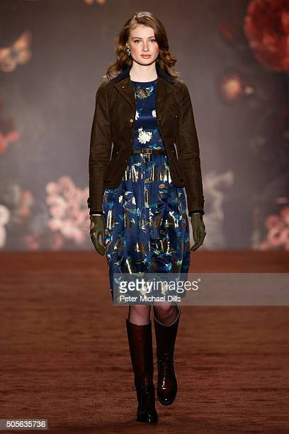 A model walks the runway at the Lena Hoschek show during the MercedesBenz Fashion Week Berlin Autumn/Winter 2016 at Brandenburg Gate on January 19...