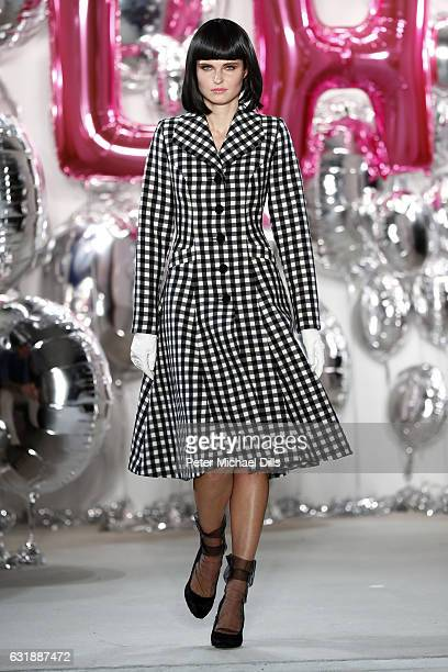 Model walks the runway at the Lena Hoschek show during the Mercedes-Benz Fashion Week Berlin A/W 2017 at Kaufhaus Jandorf on January 17, 2017 in...