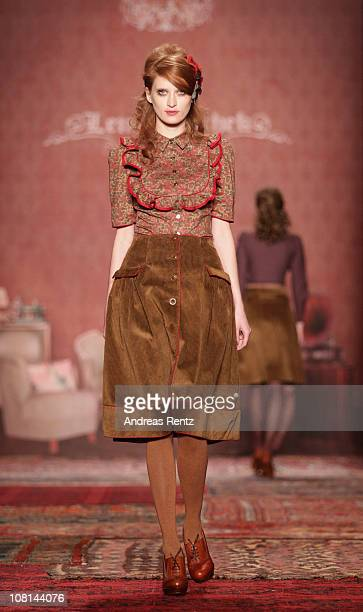A model walks the runway at the Lena Hoschek Show during the Mercedes Benz Fashion Week Autumn/Winter 2011 at Bebelplatz on January 19 2011 in Berlin...