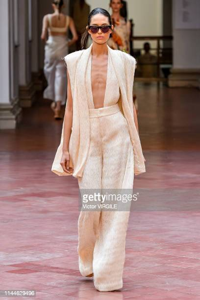 A model walks the runway at the Lenny Niemeyer fashion show during Sao Paulo Fashion Week N47 Summer 2020 on April 23 2019 in Sao Paulo Brazil
