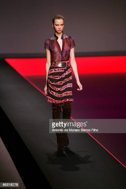 Model walks the runway at the Leonard Ready-to-Wear A/W 2009 fashion show during Paris Fashion Week at Le Carrousel du Louvre on March 9, 2009 in...