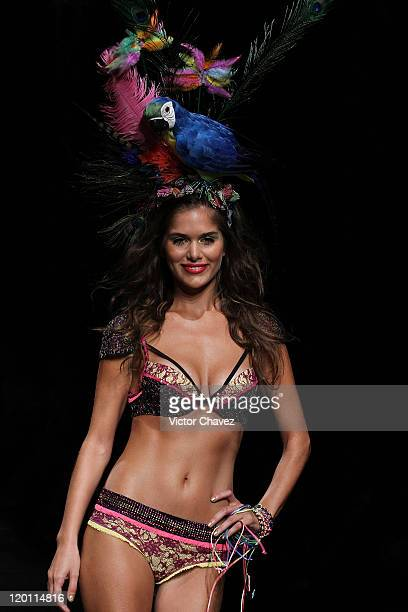Model walks the runway at the Leonisa fashion show on the third day of Colombiamoda 2011 at Museo De Arte Moderno de Medellin on July 27, 2011 in...