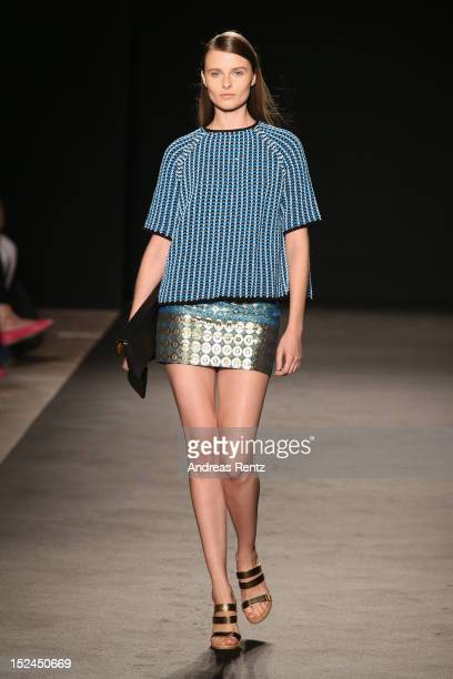 A model walks the runway at the Les Copains Spring/Summer 2013 fashion show as part of Milan Womenswear Fashion Week on September 21 2012 in Milan...