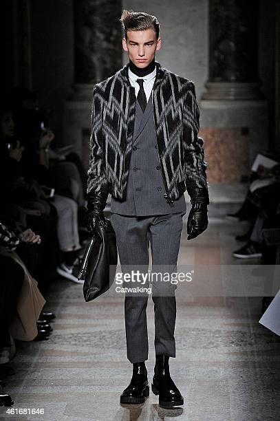 Model walks the runway at the Les Hommes Autumn Winter 2015 fashion show during Milan Menswear Fashion Week on January 17, 2015 in Milan, Italy.