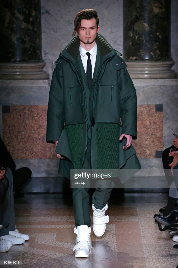 A model walks the runway at the Les Hommes show during Milan Men's Fashion Week Fall/Winter 2018/19 on January 13, 2018 in Milan, Italy.