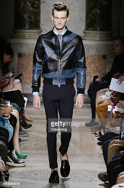Model walks the runway at the Les Hommes Spring Summer 2015 fashion show during Milan Menswear Fashion Week on June 21, 2014 in Milan, Italy.