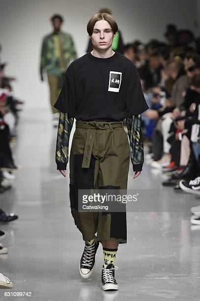 Model walks the runway at the Liam Hodges Autumn Winter 2017 fashion show during London Menswear Fashion Week on January 6, 2017 in London, United...
