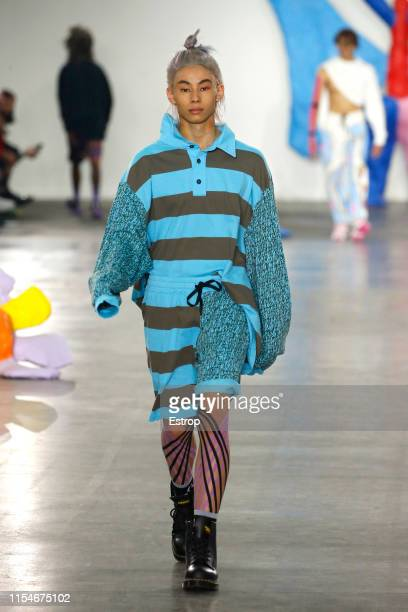 Model walks the runway at the Liam Hodges fashion show during London Fashion Week Men's June 2019 on June 8, 2019 in London, England.