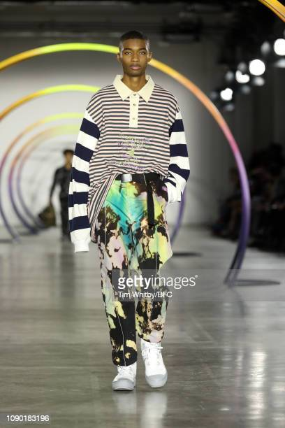 Model walks the runway at the Liam Hodges show during London Fashion Week Men's January 2019 at the BFC Show Space on January 05, 2019 in London,...