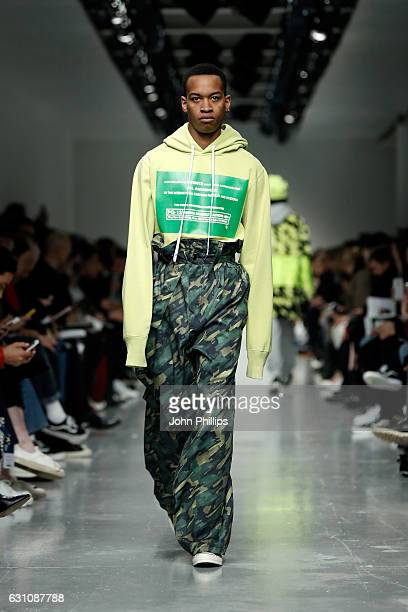 Model walks the runway at the Liam Hodges show during London Fashion Week Men's January 2017 collections at BFC Show Space on January 6, 2017 in...