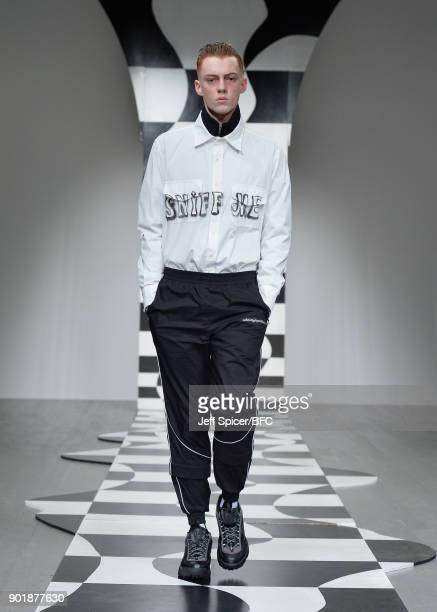 Model walks the runway at the Liam Hodges show during London Fashion Week Men's January 2018 at BFC Show Space on January 6, 2018 in London, England.