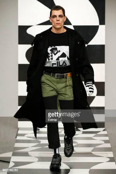 A model walks the runway at the Liam Hodges show during London Fashion Week Men's January 2018 at BFC Show Space on January 6 2018 in London England