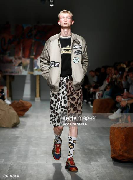 Model walks the runway at the Liam Hodges show during London Fashion Week Men's June 2018 at BFC Show Space on June 9, 2018 in London, England.