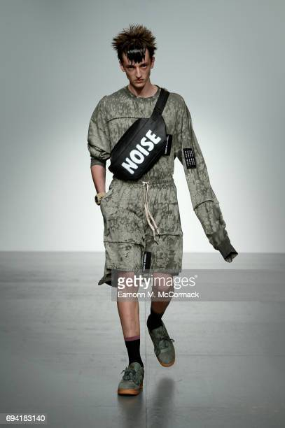 Model walks the runway at the Liam Hodges show during the London Fashion Week Men's June 2017 collections on June 9, 2017 in London, England.