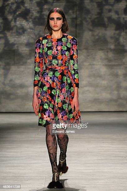 A model walks the runway at the Libertine fashion show during MercedesBenz Fashion Week Fall 2015 at The Pavilion at Lincoln Center on February 16...