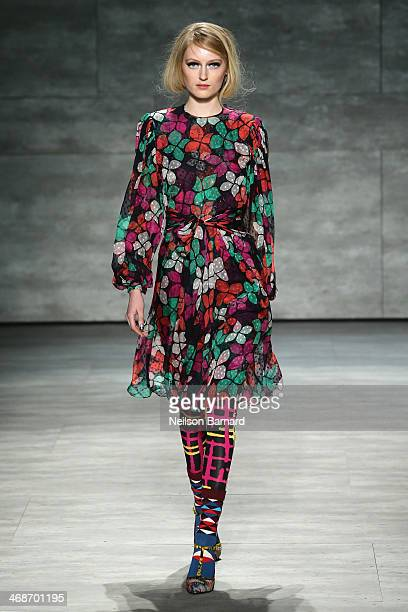 A model walks the runway at the Libertine fashion show during MercedesBenz Fashion Week Fall 2014 at The Pavilion at Lincoln Center on February 11...