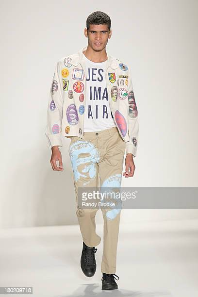 A model walks the runway at the Libertine show during Spring 2014 MercedesBenz Fashion Week at The Studio at Lincoln Center on September 9 2013 in...