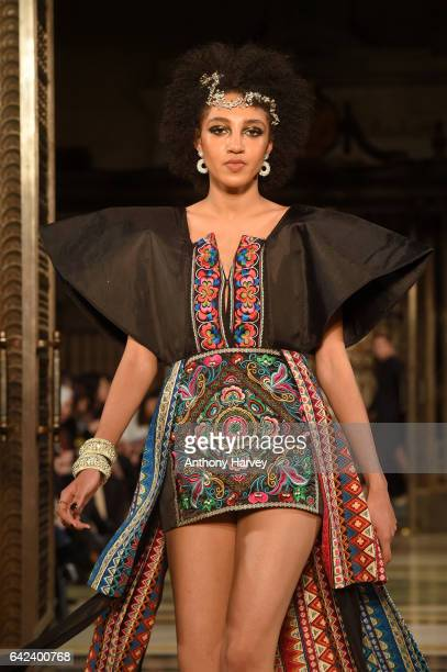 A model walks the runway at the Limkokwing University show at Fashion Scout during the London Fashion Week February 2017 collections on February 17...