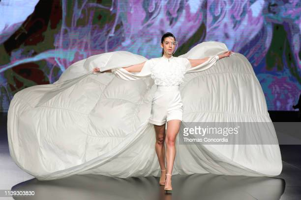 A model walks the runway at the Lindt Chocolate Couture show during Jordan Fashion Week 019 at the Kempinski Amman on March 30 2019 in Amman Jordan