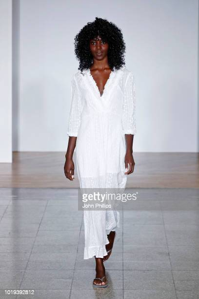 A model walks the runway at the Line of Oslo show during Oslo Runway SS19 at Bankplassen 4 on August 15 2018 in Oslo Norway
