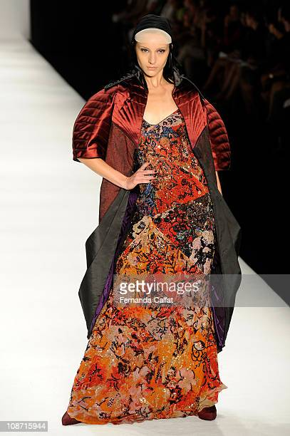 A model walks the runway at the Lino Villaventura show during the fifth day of Sao Paulo Fashion Week Fall 2011 at Ibirapuera's Bienal Pavilion on...