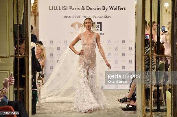 A model walks the runway at the Liu Lisi show as part of Paris Fashion Week Haute Couture Fall Winter 18/19 at Le Meurice on July 5 2018 in Paris...