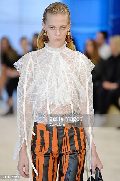 A model walks the runway at the Loewe Spring Summer 2017 fashion show during Paris Fashion Week on September 30 2016 in Paris France