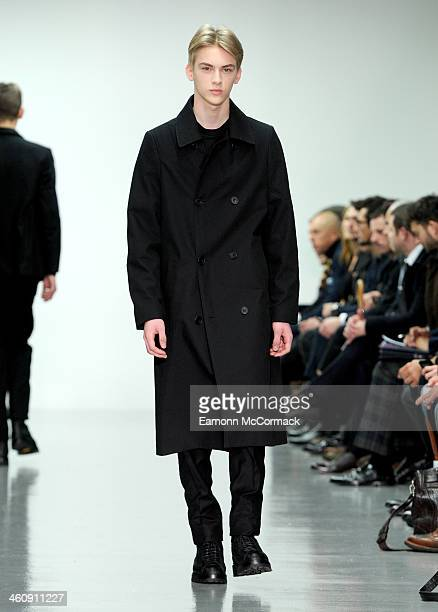 Model walks the runway at the Lou Dalton show during The London Collections: Men Autumn/Winter 2014 on January 6, 2014 in London, England.