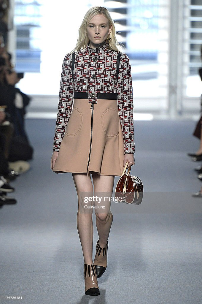 A model walks the runway at the Louis Vuitton Autumn Winter 2014 fashion show during Paris Fashion Week on March 5, 2014 in Paris, France.