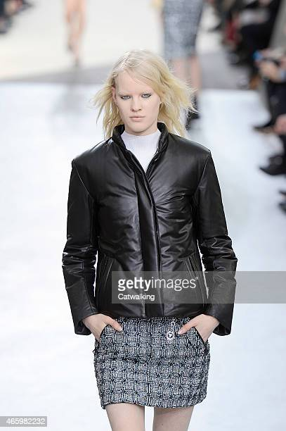 A model walks the runway at the Louis Vuitton Autumn Winter 2015 fashion show during Paris Fashion Week on March 11 2015 in Paris France