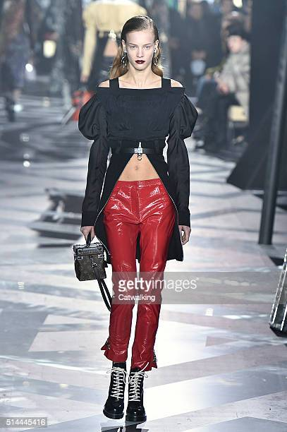 A model walks the runway at the Louis Vuitton Autumn Winter 2016 fashion show during Paris Fashion Week on March 9 2016 in Paris France