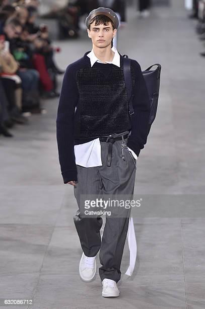 A model walks the runway at the Louis Vuitton Autumn Winter 2017 fashion show during Paris Menswear Fashion Week on January 19 2017 in Paris France
