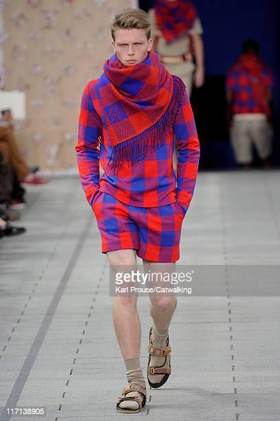 Model walks the runway at the Louis Vuitton menswear fashion show during Paris Fashion Menswear Week on June 23, 2011 in Paris, France.