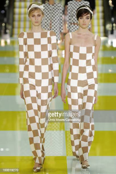 Model walks the runway at the Louis Vuitton Spring Summer 2013 fashion show during Paris Fashion Week on October 3, 2012 in Paris, France.
