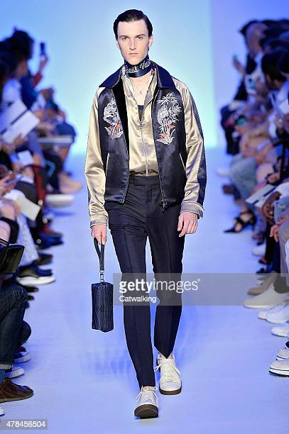 A model walks the runway at the Louis Vuitton Spring Summer 2016 fashion show during Paris Menswear Fashion Week on June 25 2015 in Paris France