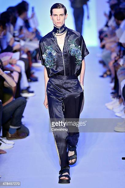 A model walks the runway at the Louis Vuitton Spring Summer 2016 fashion show during Paris Menswear Fashion Week on June 25 2015 in Paris France