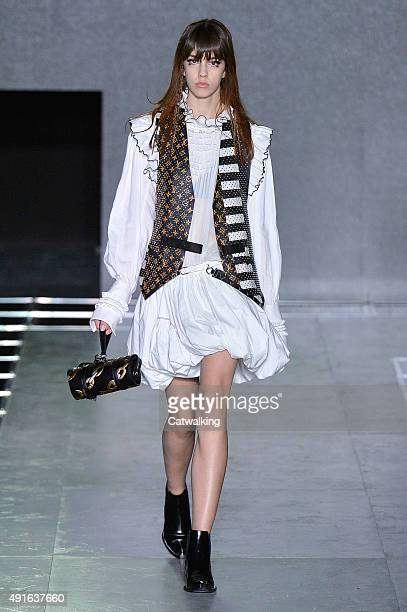 A model walks the runway at the Louis Vuitton Spring Summer 2016 fashion show during Paris Fashion Week on October 7 2015 in Paris France