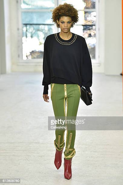 A model walks the runway at the Louis Vuitton Spring Summer 2017 fashion show during Paris Fashion Week on October 5 2016 in Paris France